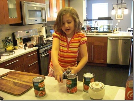 My daughter opening cans