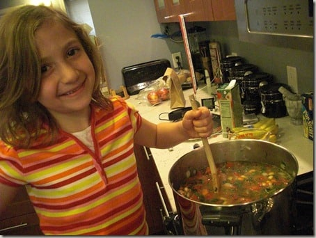 My daughter stirring soup