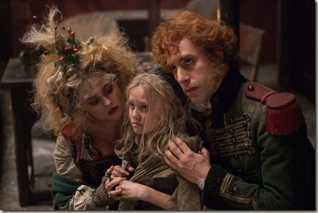 "Madame Thénardier (HELENA BONHAM CARTER) and Monsieur Thénardier (SACHA BARON COHEN) try to exploit Young Cosette (ISABELLE ALLEN) in ""Les Misérables"", the motion-picture adaptation of the beloved global stage sensation seen by more than 60 million people in 42 countries and in 21 languages around the globe and still breaking box-office records everywhere in its 28th year."