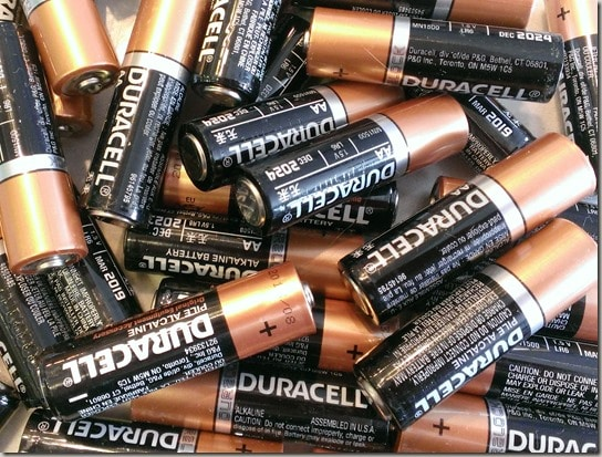 a pile of Duracell batteries