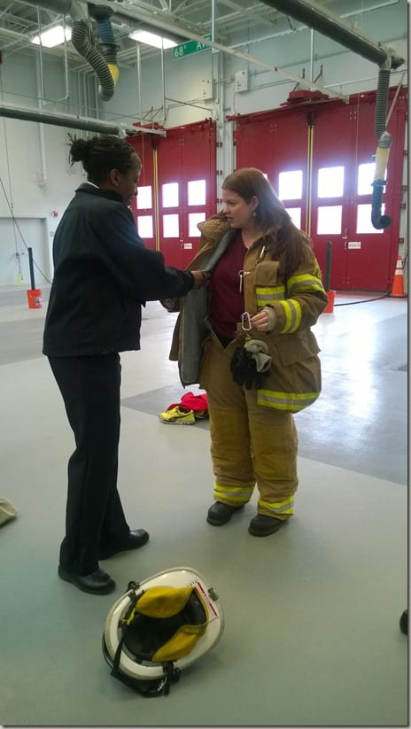 SelfishMom trying on firefighter gear