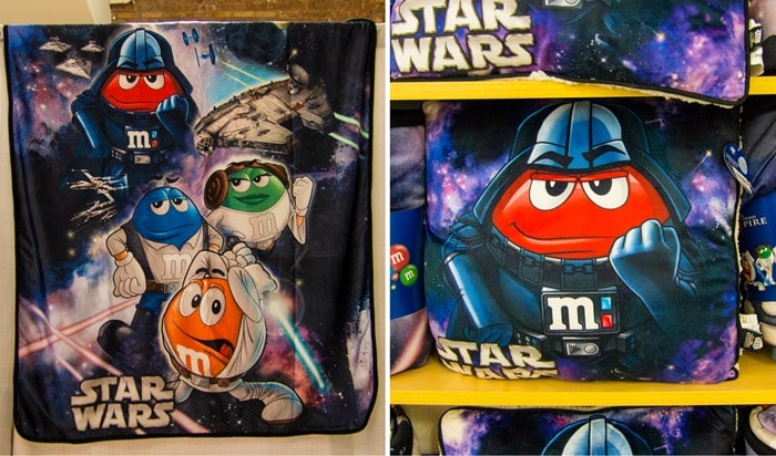 M&M's World Pop-Up Store NYC SoHo Star Wars blanket and pillow with Darth Vader, Han Solo, Luke, and Leia