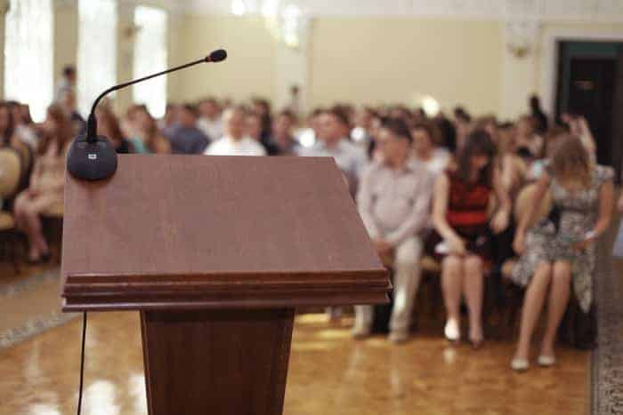 Empty podium in front of an audience