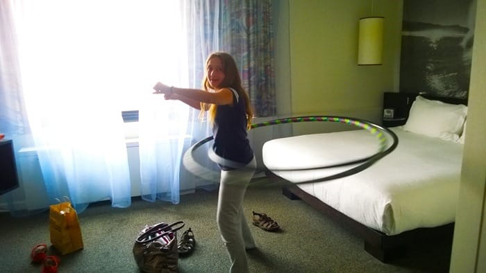 My daughter hula hooping in our hotel room in Washington D.C.