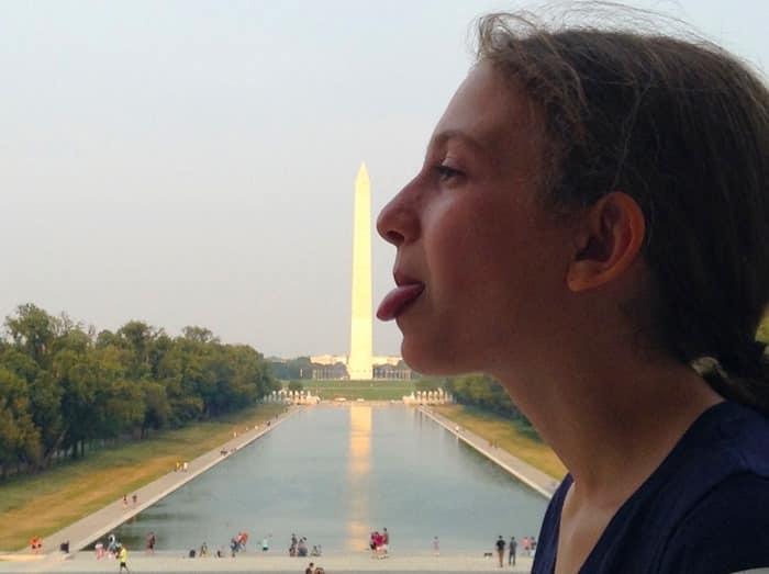 My daughter licking Washington Monument in Washington D.C.