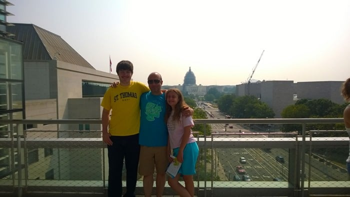 Jake, Omer, and Fiona with Capitol Building in background at the Newseum in Washington D.C.