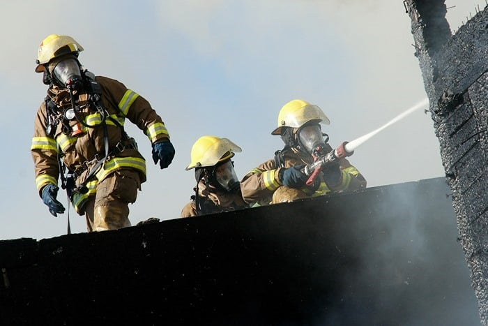 Firefighters in gear with hose