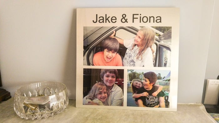 Pictures of Jake and Fiona on a metal panel from York Photo, sitting on my mantle