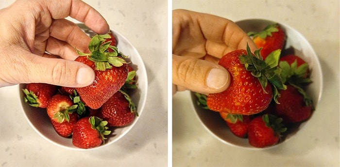 holding strawberries with the foodie app