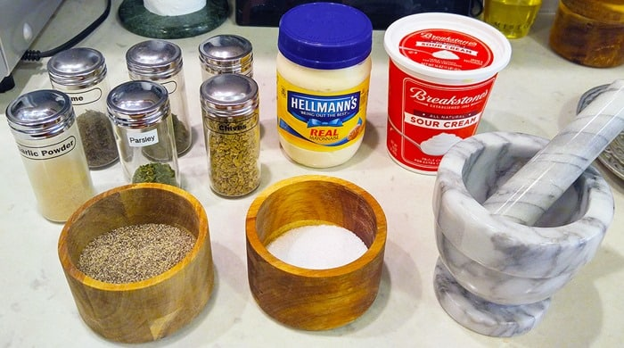 3-Minute Ranch Dressing ingredients, including herbs, salt, pepper, mayonnaise, and sour cream, plus a mortar and pestle
