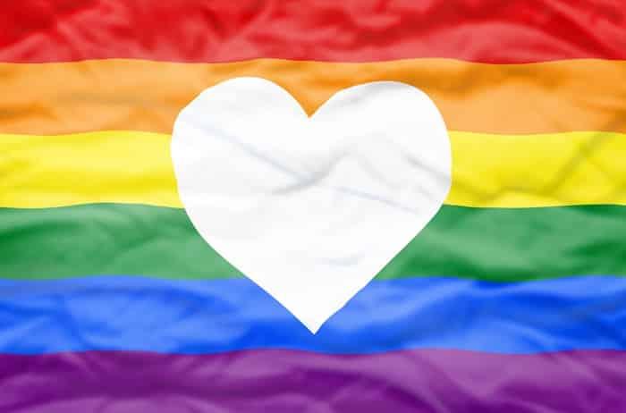 Rainbow flag with white heart cutout alt