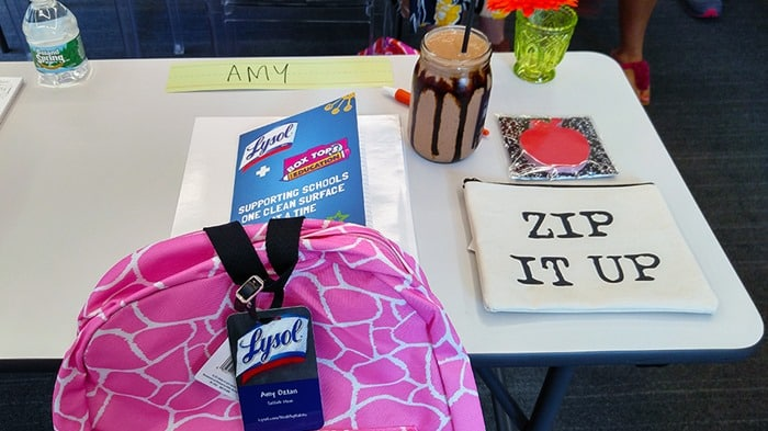 Lysol Germ School - my desk, with a backpack, notebook, pencil case, and smoothie