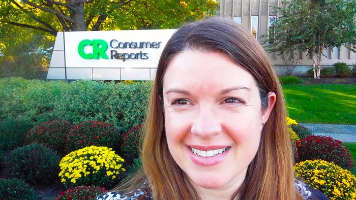 Consumer Reports Ambassadors HQ Tour 2016 - Amy Oztan in front of the Consumer Reports sign