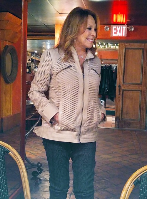 Marlo Thomas showing off her That Woman jacket and pants