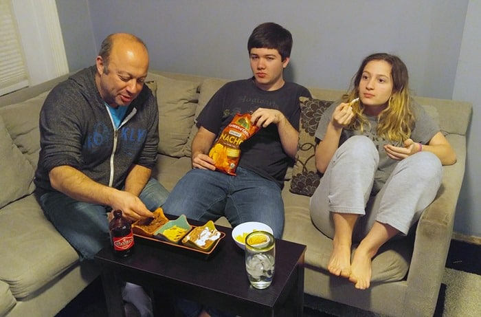 Game Day Babbleboxx - my family enjoying the food and beer on the couch while watching TV