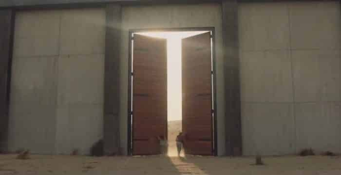 "84 Lumber Super Bowl ad - a big glowing ""T"" formed as doors open into sunlight"