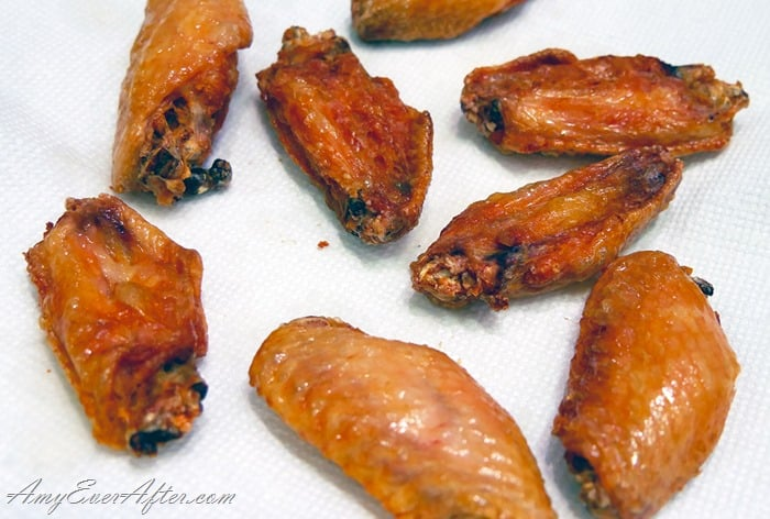 deep-fried Buffalo chicken wings on paper towel