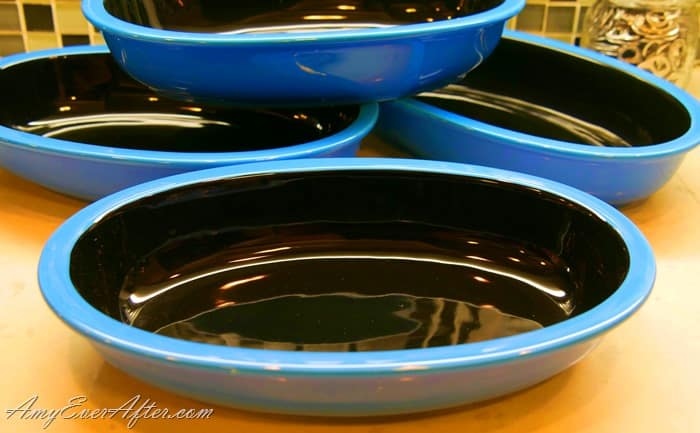 Blue and black oval baking dishes for making baked eggs and other smaller foods