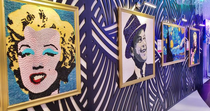 Candytopia artwork hanging on a wall, depicting Marilyn Monroe, Frank Sinatra, and others