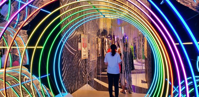 A colorful tunnel leading to another Candytopia room