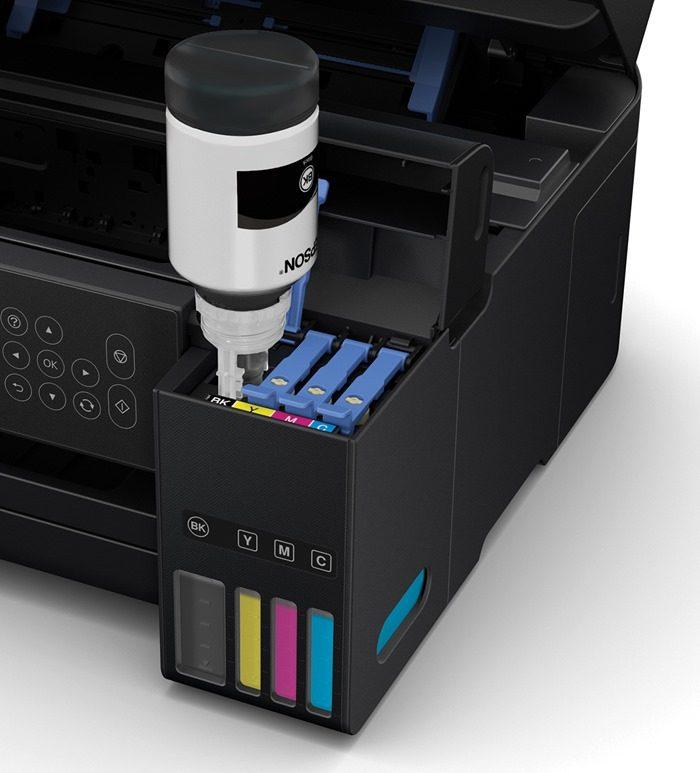 Epson EcoTank refill bottle upside-down filling an ink tank.