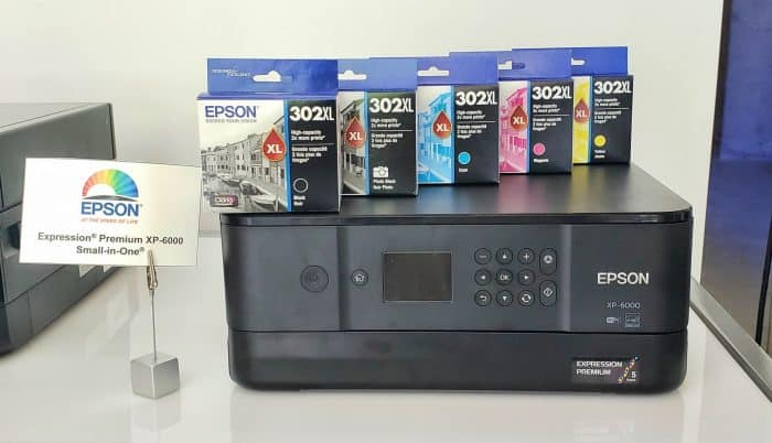 The Epson Expression Premium XP-6000 printer with five boxes of ink on top