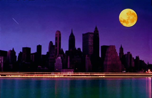 A picture of the NYC skyline during the blackout of 1965, with a big orange/red moon in the top right corner.