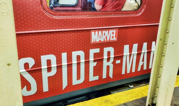 """""""Marvel Spider-Man"""" on the outside of a NYC subway car."""