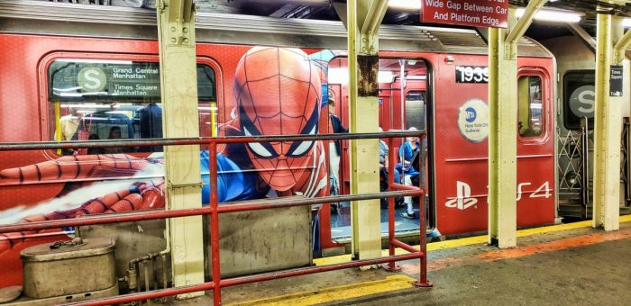 Spider-Man's face on the side of a NYC subway car