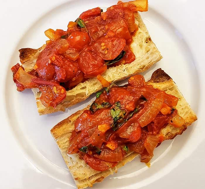 Chunky tomato sauce on toasted bread