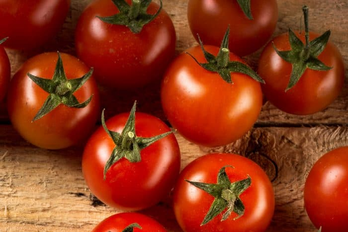 cherry tomatoes on a wood background