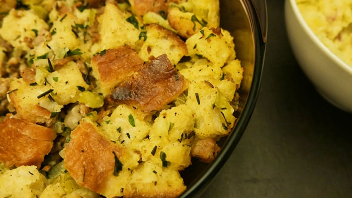 close up of make-ahead sausage stuffing in a casserole dish