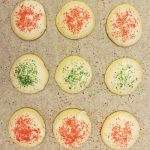 It's almost time for holiday cookie exchanges and parties, and these Minty Holiday Cookies are pretty, delicious, and a little bit out of the ordinary! They're based on the recipes for poplular black and white cookies, but with peppermint flavor instead of lemon. They're decorated with colorful sugar, so you can tailor them to any holiday! Use red and green sugar for Christmas, blue sugar for Hanukkah, or pink sugar for Valentines Day! #recipe #baking #cookies