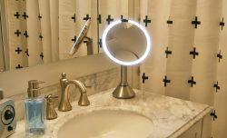 SimpleHuman sensor mirror on a bathroom counter