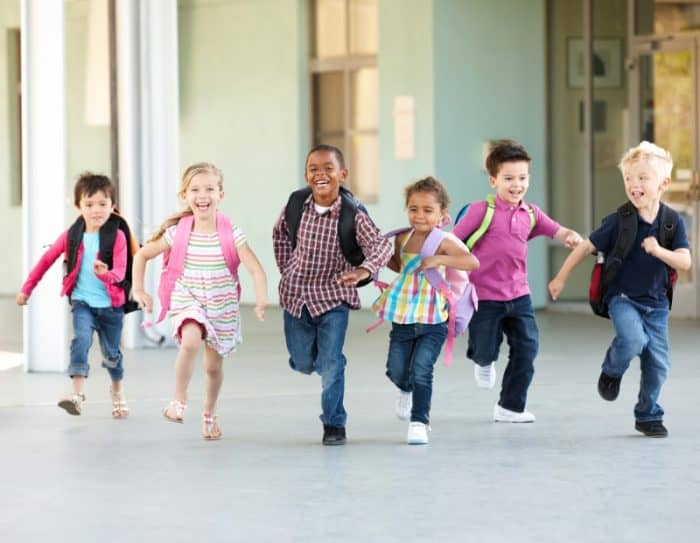 Kids running together on the last day of school