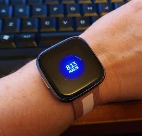 Fitbit Versa 2 in Grey Smoke with pink athleisure band, on my wrist