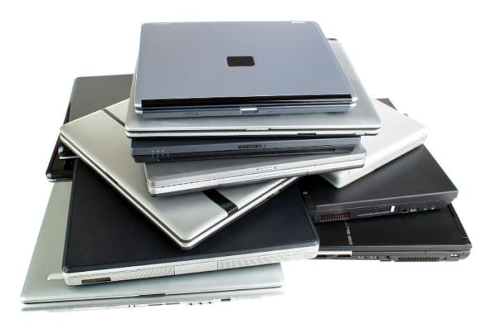 pile of laptop computers