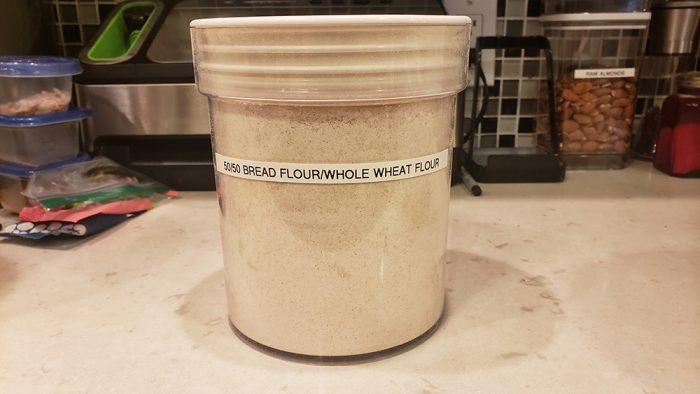 A canister with half whole wheat flour and half bread flour