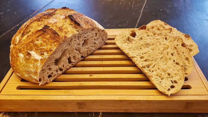 Sliced sourdough bread on a bread board