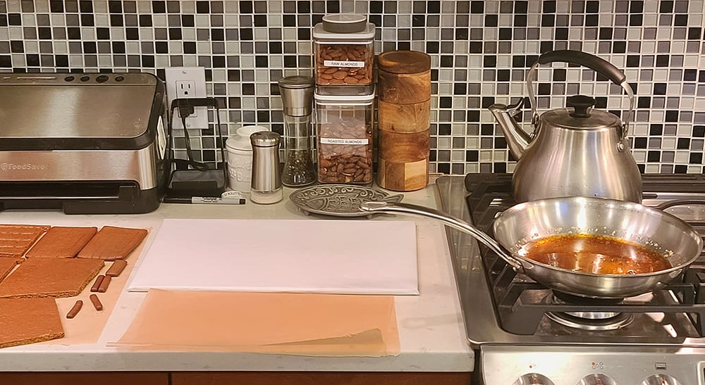 a counter with gingerbread pieces on it